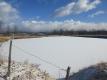 ため池に積もった雪